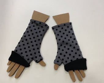 Gray fingerless gloves with black polka dots and plain black, reversible design