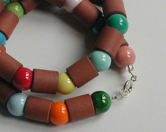 Terracotta tubes, colourful glazed porcelain spheres necklace, silver clasp