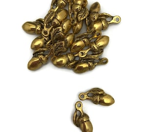 14 antique golden  acorn charms in metal  alloy