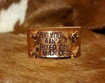 Rodeo Fan, Buck Off bracelet