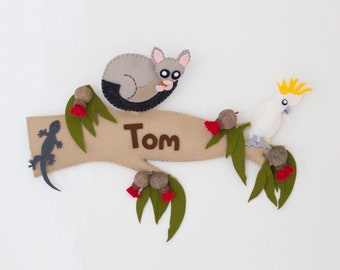 Australian animal personalized childrens name sign / wall hanging. Gum tree branch with possum, cockatoo and lizard.