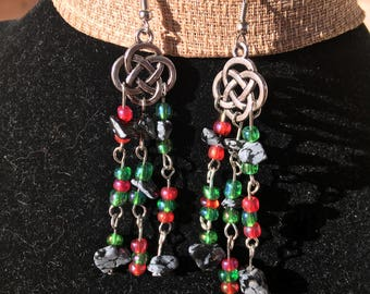 Celtic knot earrings with snowflake obsidian and red and green seed beads.