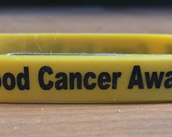 Childhood cancer awareness silicone bracelet.