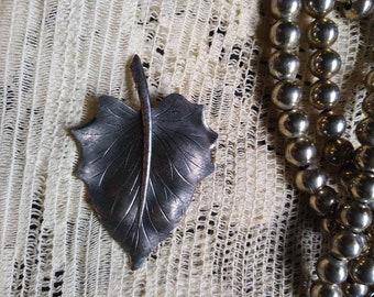 Marked sterling leaf brooch.