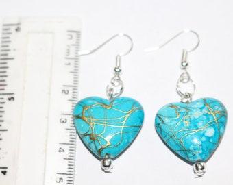 Mottled blue heart bead earrings