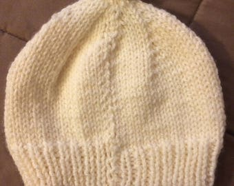 White knit hat with Pom-pom