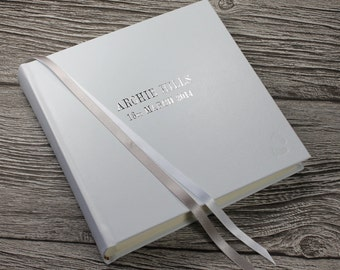 "Personalised baby photo album in white leather with baby footprint and silver & white ribbon page marker - 9"" x 8.75"""