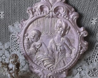 Vintage chalkware wall medallion,french country cottage, pink antiqued
