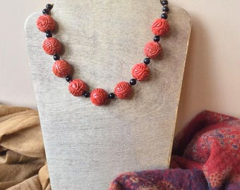 Coral and obsidian necklace