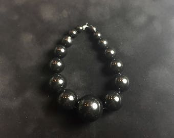 Graduated Round Acrylic Beads in Black ... 15 ct.
