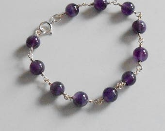 Bracelet of African Amethyst with sterling silver clasp to fit wrist up to 7""