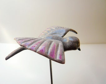 Handmade bird ceramic sculpture to decorate their home or garden