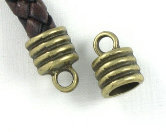 12 large antique bronze jewelry End Cap beads with loop for leather.  6.8mm inside diameter (EC7ab)