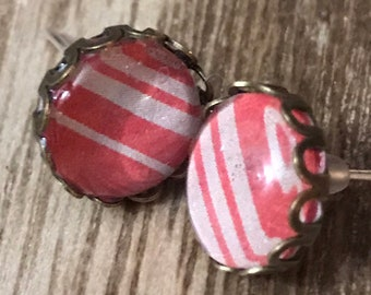 Silver stud, red and white striped earrings with a glass insert.