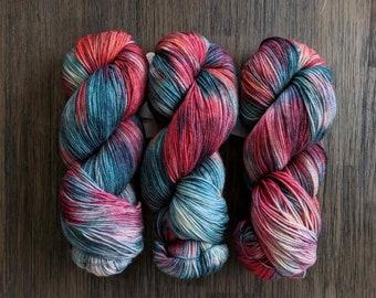 Hand Dyed Yarn - 'Alice Returns to Wonderland' - Stardust Fingering - Gold Stellina - red tea pink blue - 420 yards
