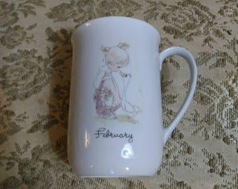 "1984 Enesco Precious Moments ""February"" Ceramic Collectible Coffee Mug Cup Birthday Gift Samuel J. Butcher"