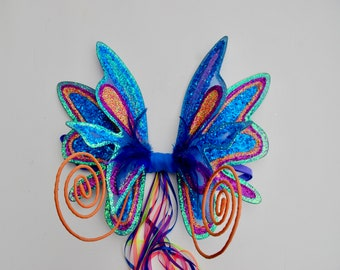Super sparkle party wings in blues and rainbow glitters with curly antennae - Fairylove