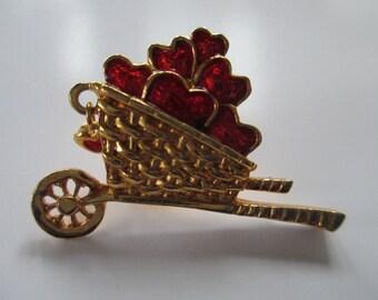 Vintage Spring Time wheelbarrow of flower hearts enamelled brooch label pin silver toned  no markings