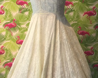 Pretty 1950's vintage yellow flocked dress