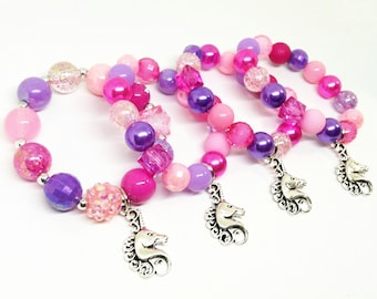 Unicorn bracelets party favors in organza bags with special birthday girl bracelet!