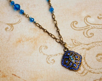 Capri Blue Rhinestone Vintage Style Pendant Necklace in Antique Brass