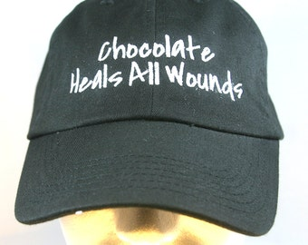 Chocolate Heals All Wounds (Polo Style Ball Black with White Stitching)