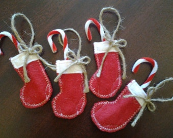 Christmas tree ornaments, 4 red and white stockings with candy canes