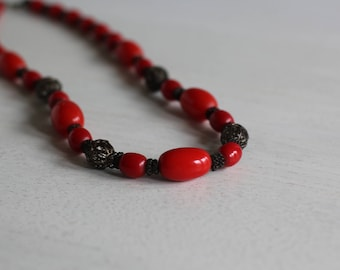 Vintage necklace with red plastic beads and metal beads