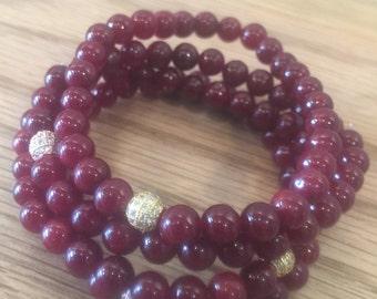 Cranberry red beaded bracelet.