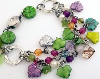 Winter Czech Glass Maple Leaves Bracelet in Shades of Green, Lime, Violet, Blue and Silver.
