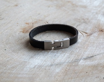 Men bracelet of black leather and stainless steel lock