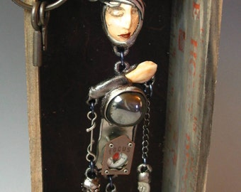 """Uniqure 3 D sculpture Mixed media Shadow Box Art to wear  Figurative One of a kind """"Focus"""" by Susan Sorrentino"""