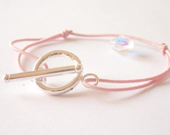 Bracelet with toggle clasp in 925 on pink cord