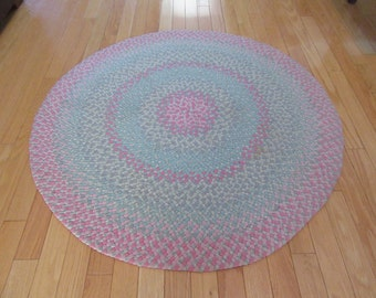 Beautiful hand round braided area rug in pastel tones- solid, nicely braided, fine condition