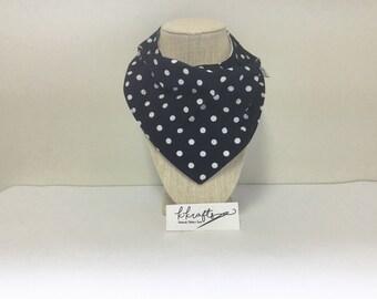 Black bib with white polka dots.