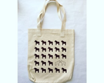 Scandinavian Dala horses kissing. Screen printed by hand on Los Angeles Apparel canvas tote bag. Made in USA