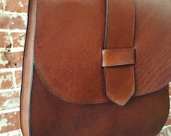 The 70's style Saddle Bag  (pictured in whiskey leather)