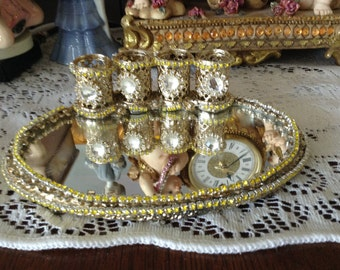 Gold jeweled lipstick holder with clear jewels