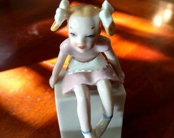 Rare period Art Deco 1940's Lenox Figurine Blue/green Mark Girl with Bows and pink dress sitting on a box