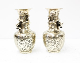 Pair of Cast Engraved Chinese Vases with Dragons