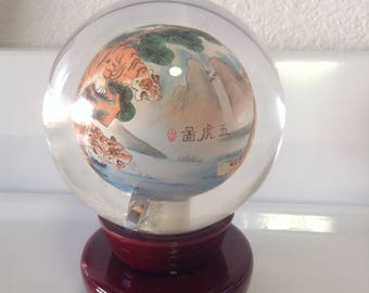 Glass orb with Chinese art