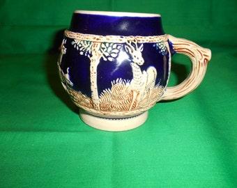 One (1), Cobalt Blue / Brown / Tan, Stoneware Mug.