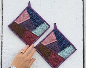 Set of quilted patchwork potholders