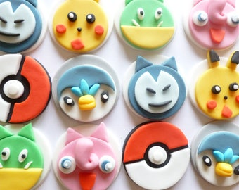 12 Pokemon Go Fondant Cupcake Toppers  - Pikachu, Jigglypuff, Snorlax and Charmander, Bulbasurn and the Poke Ball