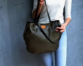 Black leather tote bag with gold dots