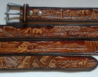 "13/4"" Wide Hand Carved Western Leather Belt details a ranch scene that is hand carved,bevelled, colored and finished ."