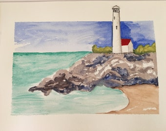 Lighthouse, seashore scene on the ocean coast; original watercolor landscape by The Praying Painter