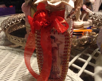 Potion bottle with images of Victorian ladies all around
