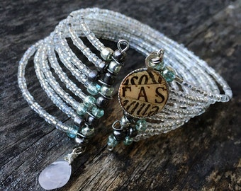 Beaded cuff bracelet with recycled wine cork charm