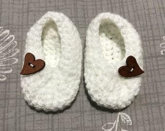 White baby slippers